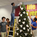 """People at Forsyth Tech decorating the """"Angel Tree"""""""