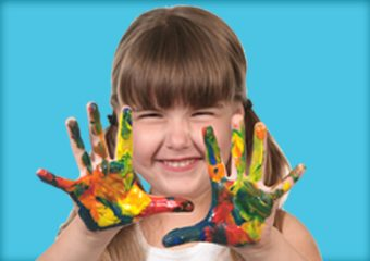 A kid with paint all over her hands