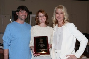 Emily & Michael Roels with an award