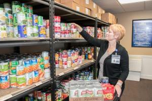 A person helping at a food bank