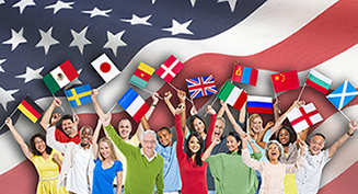 People of all diferent nationalities standing in front of an American flag
