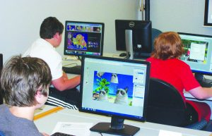 Kids using technology at Summer Camp