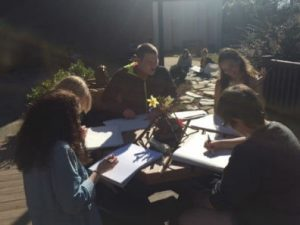 students drawing outside