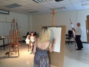 students in a figure drawing class