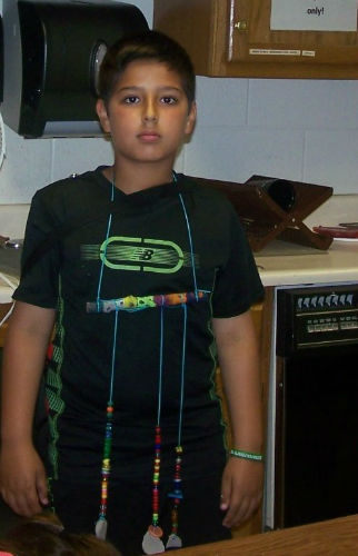 a kid wearing home made jewelry