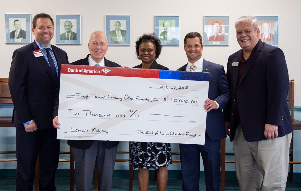 Bank of America and Forsyth Tech representatives holding a giant check