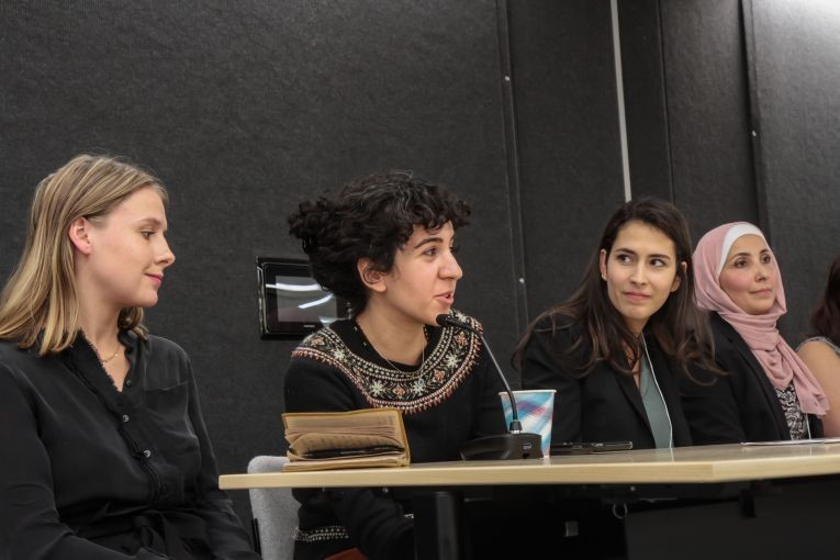 Shirin Alhroob from Forsyth Technical Community College answers a question while Mariana Rivas from Texas Christian University, Taylor Damann from Southern Illinois University Carbondale, and Cammie Behnke from Elon University listen