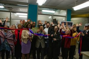 people celebrating the grand opening of Everyday Excellence Leaders