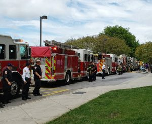Fire Trucks and Fire Men Cheering on Novant's health care workers