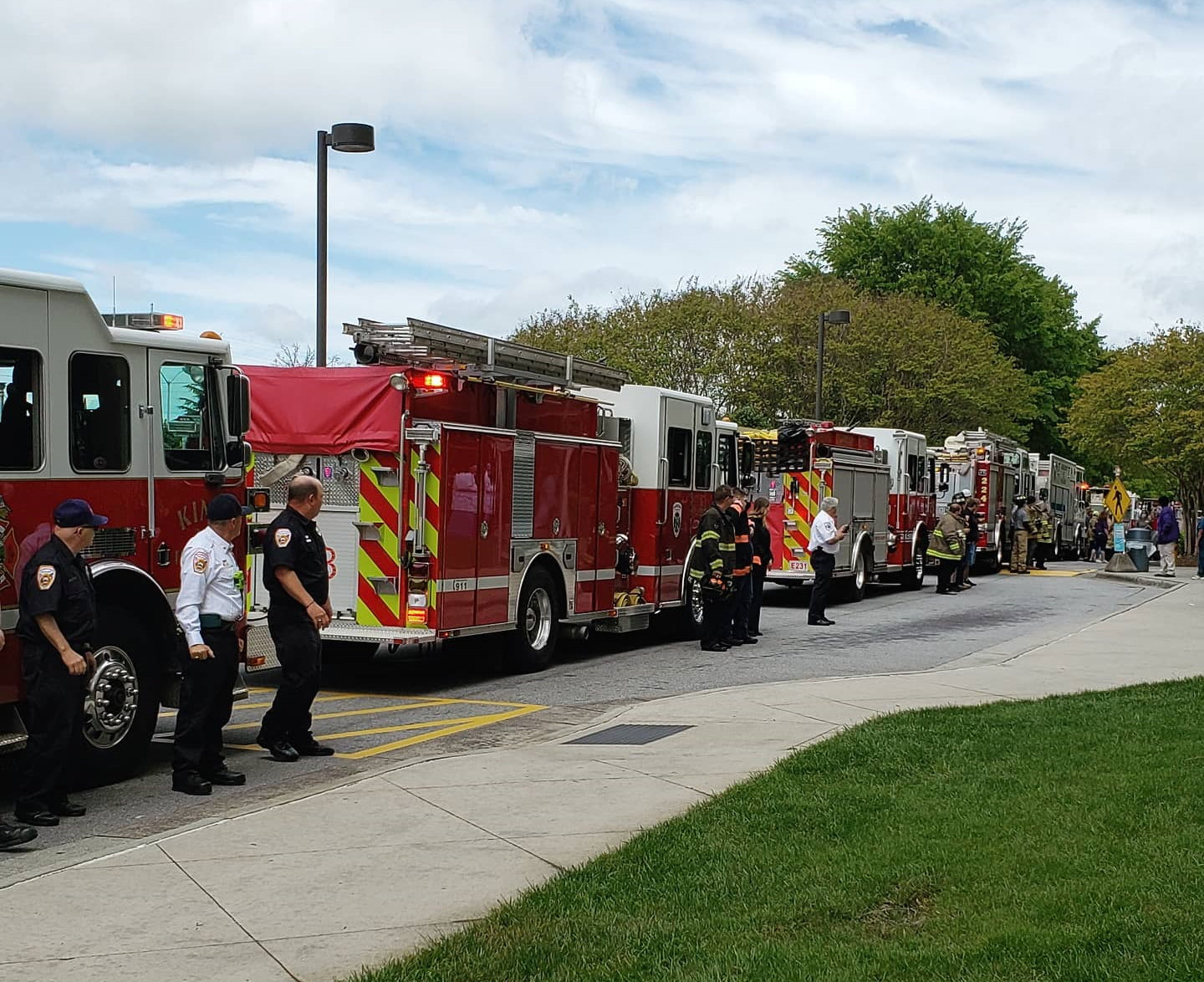 Firemen with their firetrucks cheering on healthcare workers