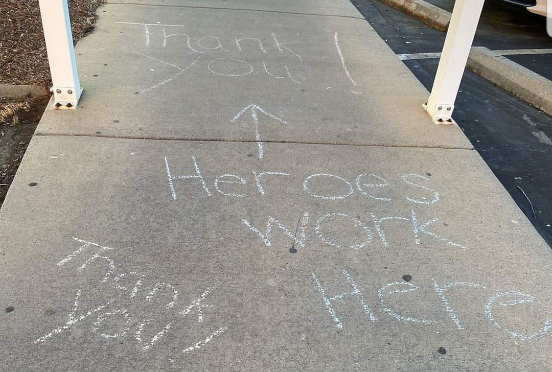 "Side walk chalk that reads ""Heroes word here"""